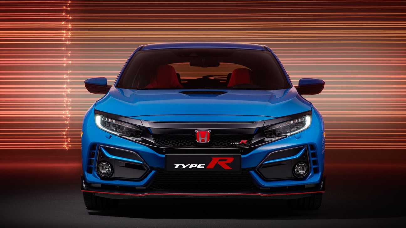 Front-facing view of Civic Type R GT displaying side grilles in street location.