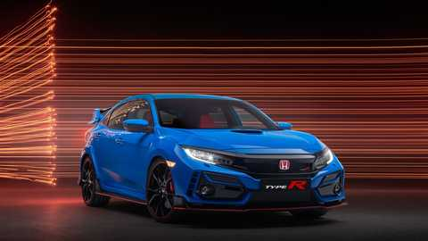 Side-facing view of Civic Type R GT in city location.