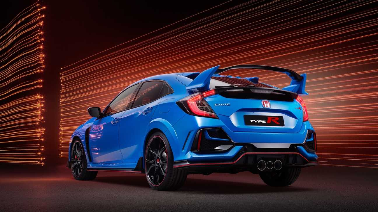 Rear facing view of Civic Type R GT displaying triple exhaust pipes in tunnel location.