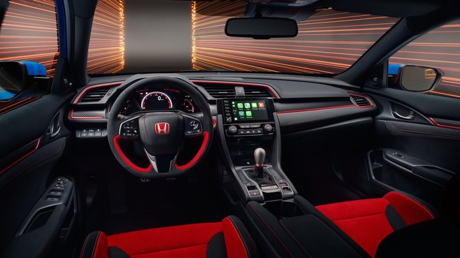 Side facing view of red interior car seats in Honda Civic Type R GT car.