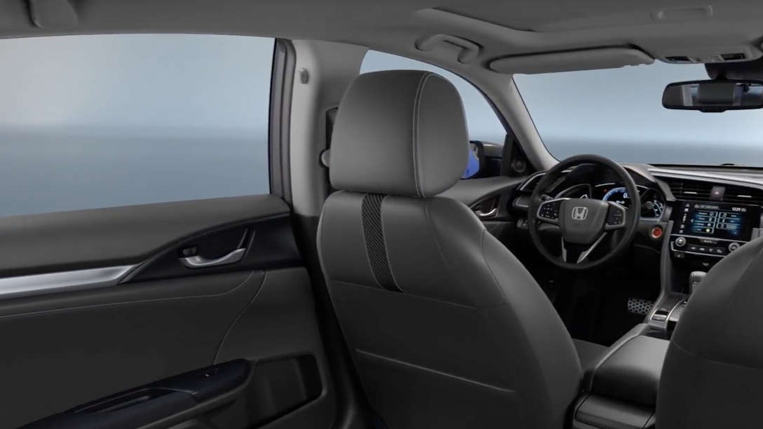 Trojštvrťový pohľad spredu na interiér vozidla Honda Civic Sedan.